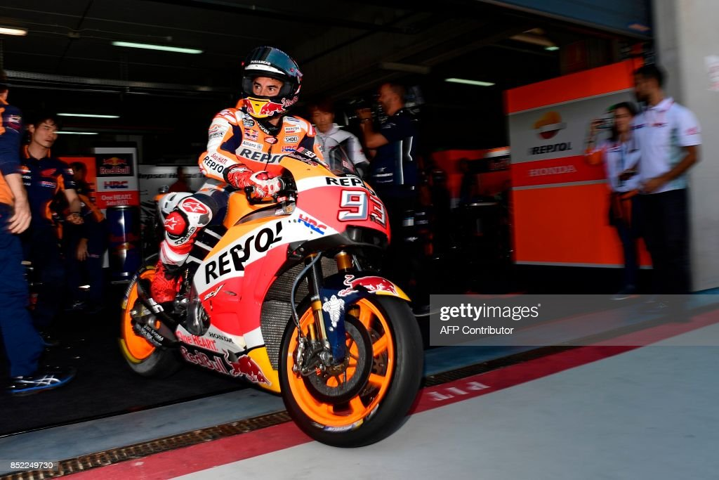 Repsol Honda Team's Spanish rider Marc Marquez leaves the box during the Moto GP fourth practice session of the Moto Grand Prix of Aragon at the Motorland circuit in Alcaniz on September 23, 2017. /
