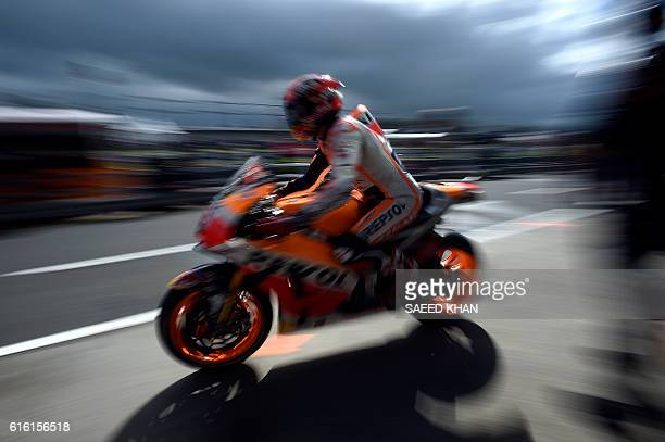 Repsol Honda Team's Spanish rider Marc Marquez leaves the pit lane during the qualifying session of the MotoGP class at the Australian Grand Prix at...