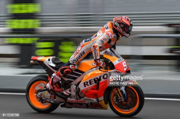 TOPSHOT Repsol Honda Team's Spanish rider Marc Marquez leaves the pit lane during the first day of the 2018 MotoGP preseason test at the Sepang...