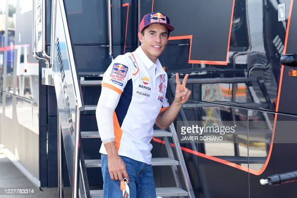 Repsol Honda Team's Spanish rider Marc Marquez makes the victory sign on the sidelines of the Andalucia Grand Prix at the Jerez race track in Jerez...