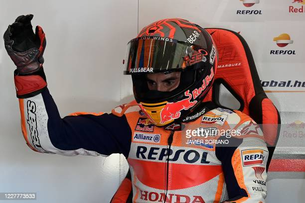 Repsol Honda Team's Spanish rider Marc Marquez moves his right arm which was operated earlier this week during the fourth MotoGP free practice...