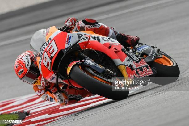 Repsol Honda Team's Spanish rider Marc Marquez negotiates a corner during the second practice session of the Malaysia MotoGP at the Sepang...