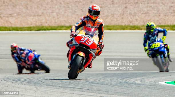 Repsol Honda Team's Spanish rider Marc Marquez reacts after he placed first in the qualifying of the Moto GP for the Grand Prix of Germany at the...