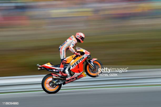 TOPSHOT Repsol Honda Team's Spanish rider Marc Marquez reacts at the end of the qualifying session of the Moto GP Grand Prix of the Czech Republic in...