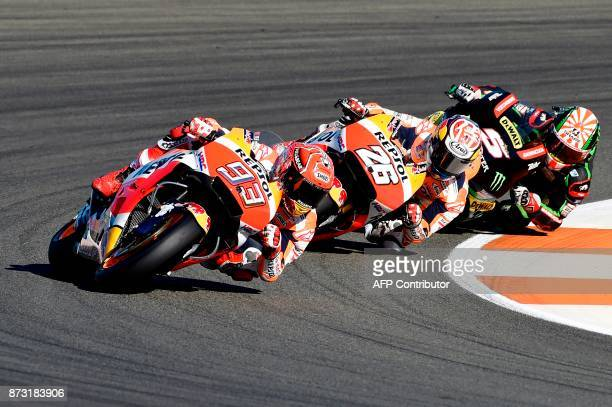 Repsol Honda Team's Spanish rider Marc Marquez Repsol Honda Team's Spanish rider Dani Pedrosa and Monster Yamaha Tech 3's French rider Johann Zarco...