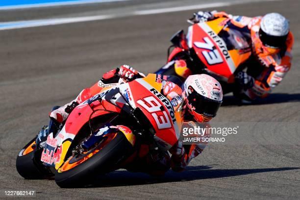 Repsol Honda Team's Spanish rider Marc Marquez rides ahead of his brother, Repsol Honda Team's Spanish rider Alex Marquez, during the first MotoGP...