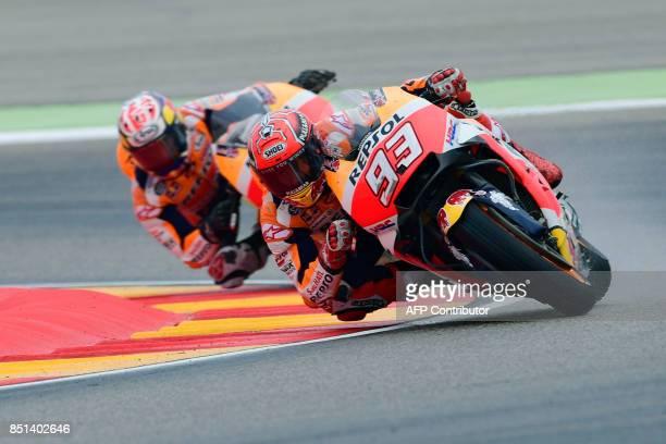 Repsol Honda Team's Spanish rider Marc Marquez rides ahead of Repsol Honda Team's Spanish rider Dani Pedrosa during the Moto GP second free pratice...