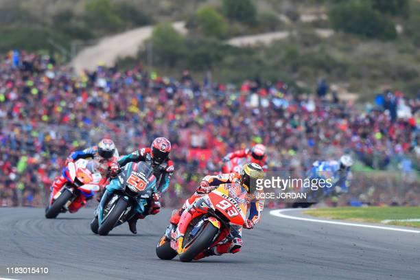 Repsol Honda Team's Spanish rider Marc Marquez rides ahead Petronas Yamaha SRT's French rider Fabio Quartararo during the MotoGP race of the MotoGP...