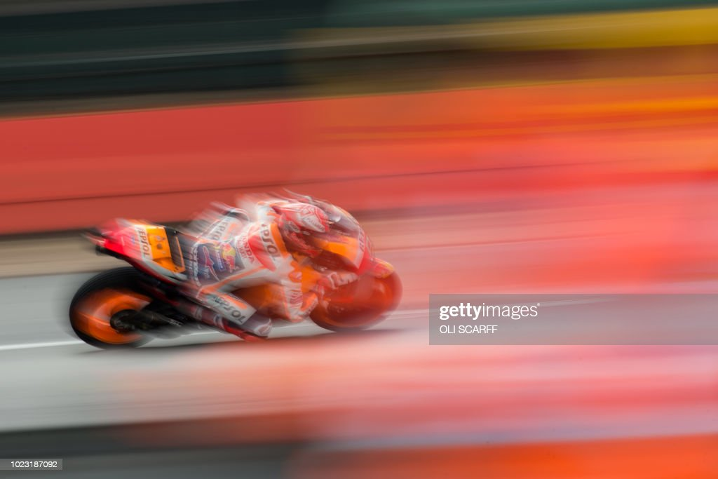TOPSHOT - Repsol Honda Team's Spanish rider Marc Marquez rides during a MotoGP qualifying session of the motorcycling British Grand Prix at Silverstone circuit in Northamptonshire, southern England, on August 25, 2018.