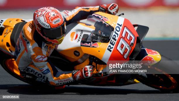 Repsol Honda Team's Spanish rider Marc Marquez rides during a MotoGP free practice session, ahead of the French Motorcycle Grand Prix, on May 18 in...
