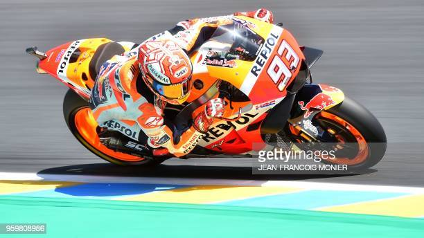 TOPSHOT Repsol Honda Team's Spanish rider Marc Marquez rides during a MotoGP free practice session ahead of the French Motorcycle Grand Prix on May...