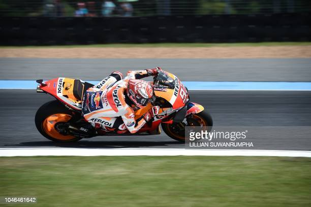 Repsol Honda Team's Spanish rider Marc Marquez rides during the final free practice session of the 2018 Thailand MotoGP at Buriram International...