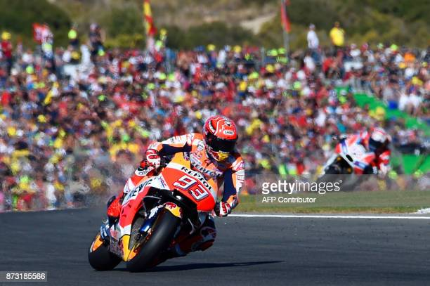 TOPSHOT Repsol Honda Team's Spanish rider Marc Marquez rides during the MotoGP race of the Valencia Grand Prix at Ricardo Tormo racetrack in Cheste...