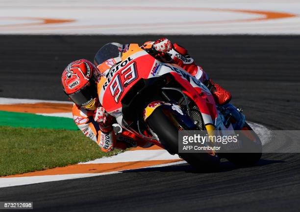 Repsol Honda Team's Spanish rider Marc Marquez rides during the MotoGP race of the Valencia Grand Prix at Ricardo Tormo racetrack in Cheste near...