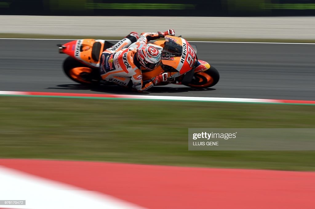 Repsol Honda Team's Spanish rider Marc Marquez rides during the Catalunya MotoGP Grand Prix qualifying session at the Catalunya racetrack in Montmelo, near Barcelona on June 16, 2018.