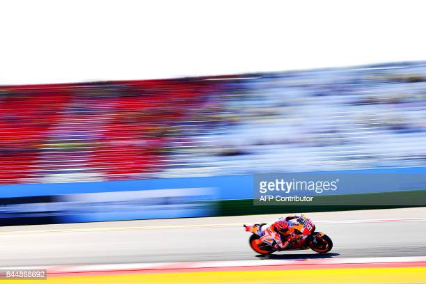 TOPSHOT Repsol Honda team's spanish rider Marc Marquez rides his bike during a practice session for the San Marino Moto GP Grand Prix race at the...