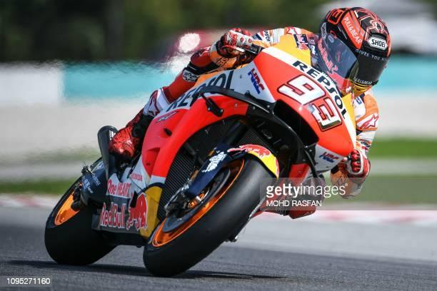 TOPSHOT Repsol Honda Team's Spanish rider Marc Marquez rides his bike during the last day of the 2019 MotoGP preseason testing at the Sepang...