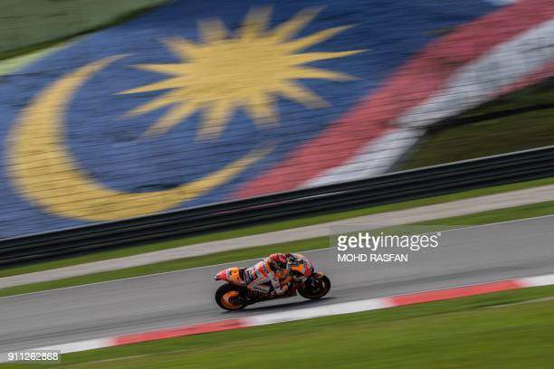 TOPSHOT Repsol Honda Team's Spanish rider Marc Marquez rides his bike during the first day of the 2018 MotoGP preseason test at the Sepang...