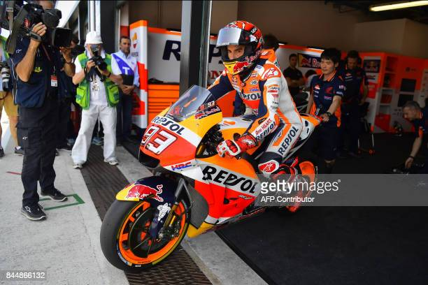 Repsol Honda Team's spanish rider Marc Marquez rides his bike out of the pit during a free practice session for the San Marino Moto GP Grand Prix...