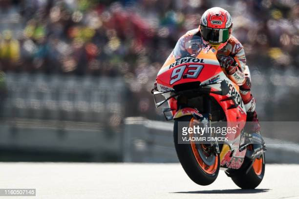Repsol Honda Team's Spanish rider Marc Marquez rides his motorbike during the third free practice session of the Austrian Moto GP Grand Prix in...