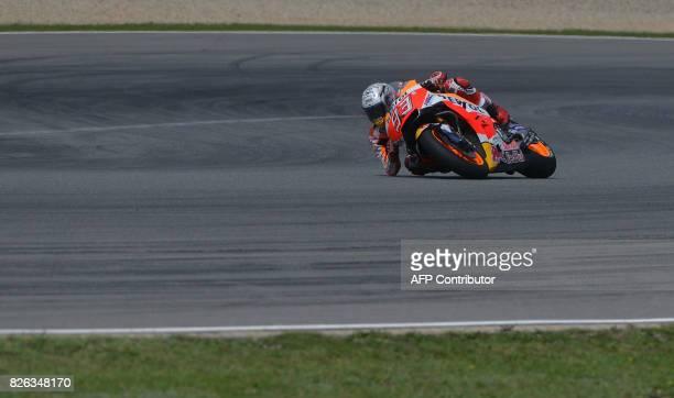 Repsol Honda Team's Spanish rider Marc Marquez rides in a free practice session prior to the Moto GP Czech Grand Prix race in Brno, Czech Republic,...