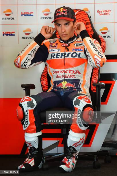 Repsol Honda Team's Spanish rider Marc Marquez sits in pits during the second MotoGP free practice session of the Moto Grand Prix de Catalunya at the...