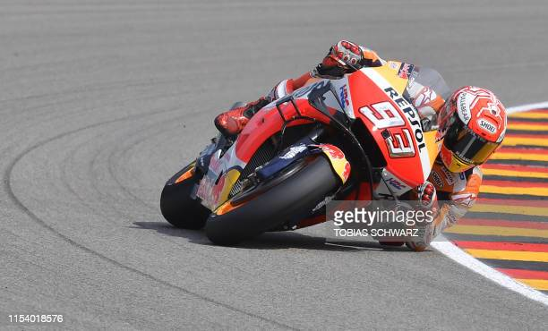 Repsol Honda Team's Spanish rider Marc Marquez steers his bike during the Moto GP free practice session for the Grand Prix of Germany on July 6, 2019...