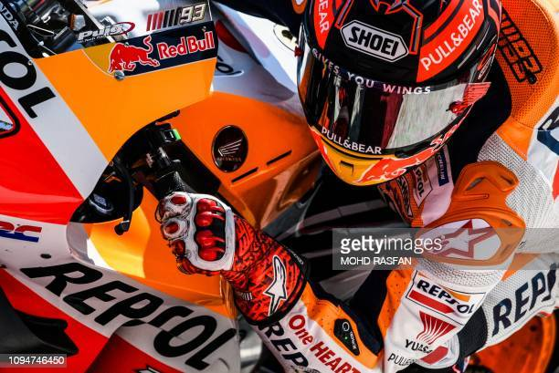 TOPSHOT Repsol Honda Team's Spanish rider Marc Marquez takes a corner during the second day of the 2019 MotoGP preseason testing at the Sepang...