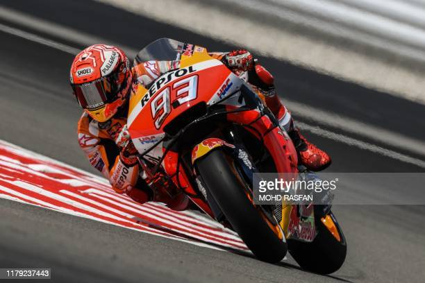 Repsol Honda Teams Spanish rider Marc Marquez takes a corner during the first MotoGP free practice at the Sepang International Circuit on November 1...