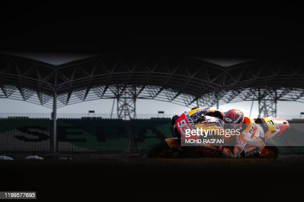 Repsol Honda Team's Spanish rider Marc Marquez takes a corner during the last day of the pre-season MotoGP winter test at the Sepang International...