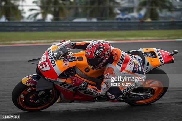 Repsol Honda Team's Spanish rider Marc Marquez takes a corner during the third practice session of 2016 Malaysian MotoGP race at Sepang International...