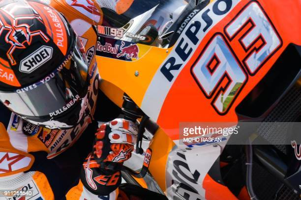 TOPSHOT Repsol Honda Team's Spanish rider Marc Marquez takes a corner during the first day of the 2018 MotoGP preseason test at the Sepang...