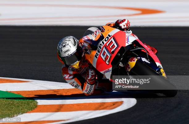 TOPSHOT Repsol Honda Team's Spanish rider Marc Marquez takes a curve during the first MotoGP free practice session of the race of the Valencia Grand...