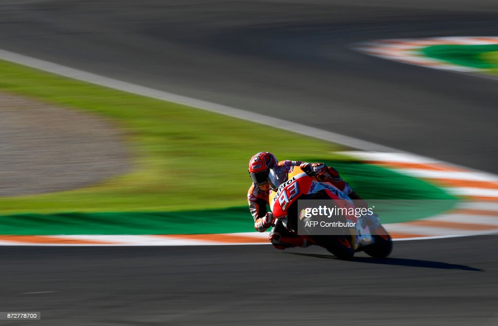 Repsol Honda Team's Spanish rider Marc Marquez takes a curve during the third MotoGP free practice session of the Valencia Grand Prix at Ricardo Tormo racetrack in Cheste, near Valencia on November 11, 2017. /