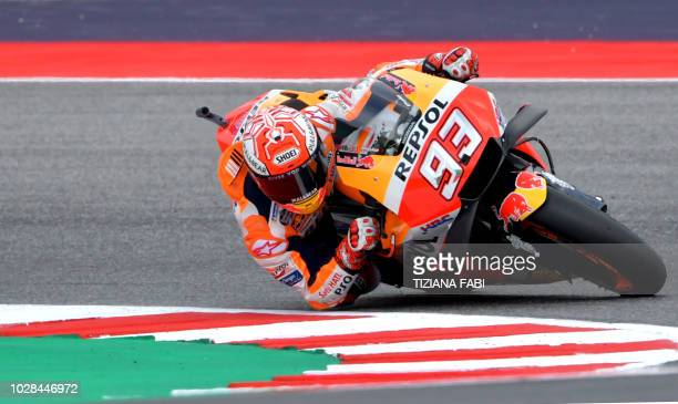 Repsol Honda Team's Spanish rider Marc Marquez takes part in the free practice session of the San Marino Moto GP Grand Prix race at the Marco...