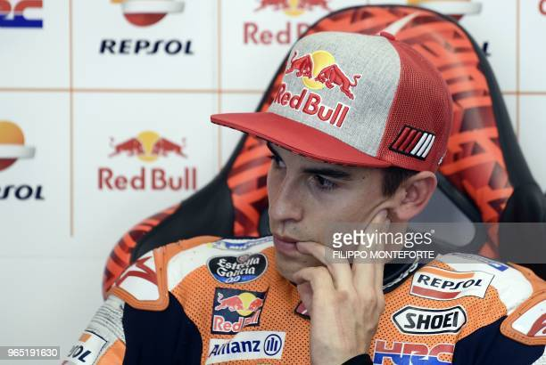 Repsol Honda Team's Spanish rider Marc Marquez watches a practice session in the box during a free practice session ahead of the Italian MotoGP Grand...