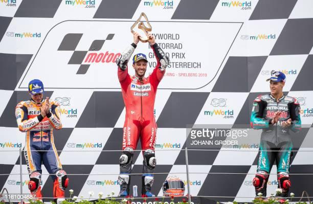 Repsol Honda Team's Spanish rider Marc Marquez winner Mission Winnow Ducati's Italian rider Andrea Dovizioso and third placed Petronas Yamaha SRT's...
