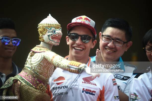 TOPSHOT Repsol Honda's MotoGP Spanish rider Marc Marquez watches a traditional Thai puppet dance during a press conference leading up to the 2018...