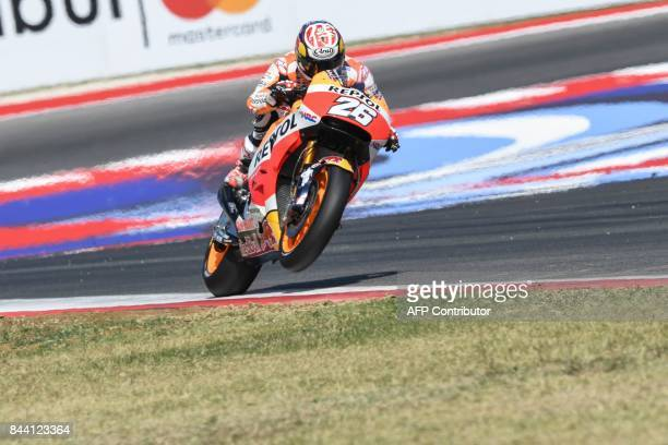 Repsol Honda's rider Dani Pedrosa competes during the free practice session at the Marco Simoncelli Circuit ahead of the San Marino Moto GP Grand...