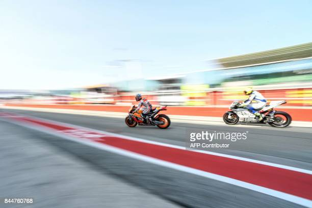 Repsol Honda's rider Dani Pedrosa rides his bike out of the pit during a free practice session of the San Marino Moto GP Grand Prix race at the Marco...
