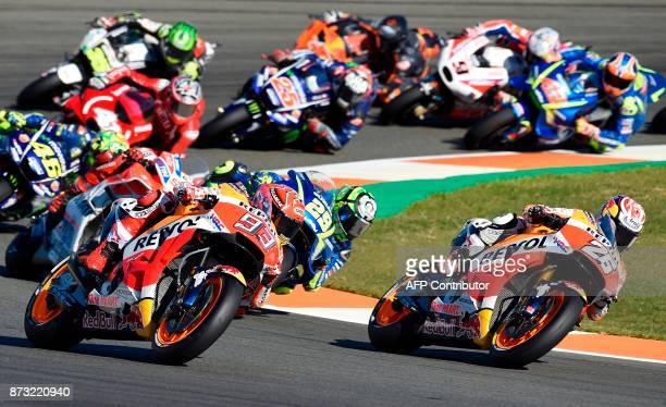 Repsol Honda's Spanish rider Dani Pedrosa rides ahead Repsol Honda's Spanish rider Marc Marquez during the MotoGP race of the Valencia Grand Prix at...
