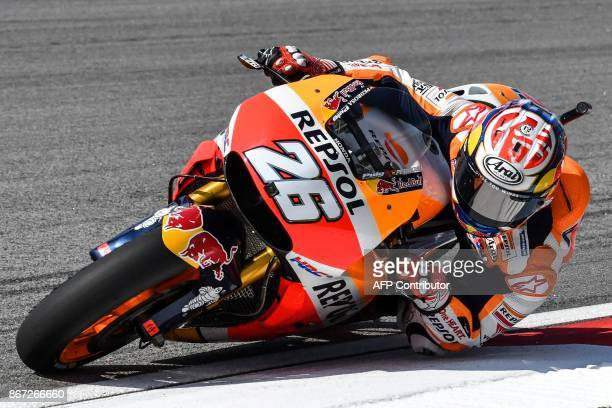 Repsol Honda's Spanish rider Dani Pedrosa takes a corner during the third practice session of the Malaysia MotoGP at the Sepang International circuit...