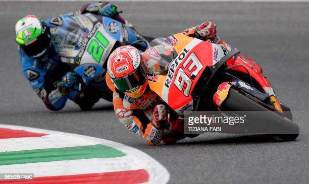 Repsol Honda's Spanish rider Marc Marquez and EG 00 Marc VDS' Italian rider Franco Morbidelli take a curve during a free practice session ahead of...