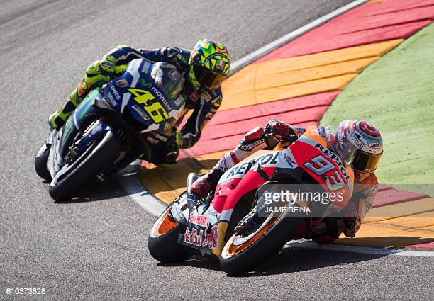 Repsol Honda's Spanish rider Marc Marquez and Yamaha Team's Italian rider Valentino Rossi compete during the Moto GP race of the Aragon Grand Prix at...
