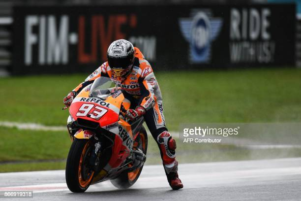 Repsol Honda's Spanish rider Marc Marquez brakes during the second practice session of the Malaysia MotoGP at the Sepang International circuit in...