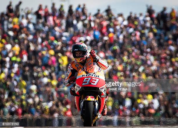 TOPSHOT Repsol Honda's Spanish rider Marc Marquez celebrates after winning the Moto GP race of the Aragon Grand Prix at the Motorland racetrack in...