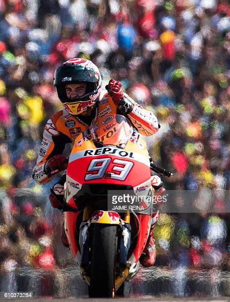 Repsol Honda's Spanish rider Marc Marquez celebrates after winning the Moto GP race of the Aragon Grand Prix at the Motorland racetrack in Alcaniz on...