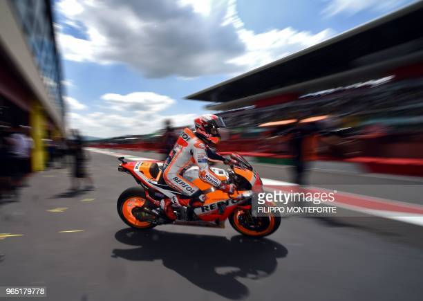 TOPSHOT Repsol Honda's Spanish rider Marc Marquez exits the pit lane during a free practice session ahead of the Italian Moto GP Grand Prix at the...