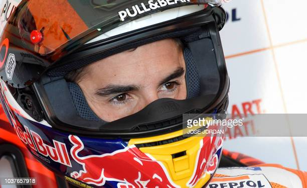 Repsol Honda's Spanish rider Marc Marquez looks on during the MotoGP fourth free practice of the Aragon Grand Prix at the Motorland racetrack in...