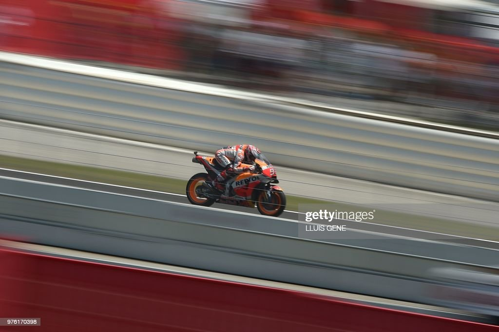 Repsol Honda's Spanish rider Marc Marquez rides during the Catalunya MotoGP Grand Prix qualifying session at the Catalunya racetrack in Montmelo, near Barcelona on June 16, 2018.